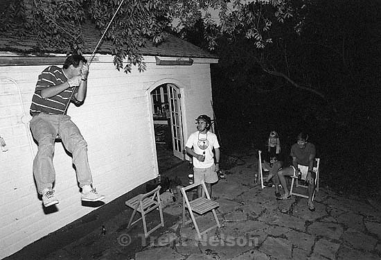 Rick Egan on the swing at Todd Crosland's house. Todd Crosland, Kristan Jacobsen, Steve Griffin on ground.<br />