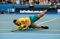 9th January 2020; Sydney Olympic Park Tennis Centre, Sydney, New South Wales, Australia; ATP Cup Australia, Sydney, Day 7; Great Britain versus Australia; Cameron Norrie of Great Britain versus Nick Kyrgios of Australia; Nick Kyrgios of Australia takes a fall but still wins the point against Cameron Norrie of Great Britain - Editorial Use