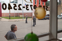 state troopers at a road block in Friendship NY as seen through the window of a local coffee shop. 6/21/2015 Brendan Bannon, Friendship, NY.