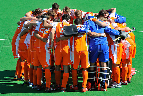 02.12.2012 Melbourne, Australia. Players from the Netherlands huddle before the start of the match in the Men's Hockey Champions Trophy from the State Netball Hockey Centre.