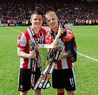 Lincoln City's Billy Knott, left, with team-mate Terry Hawkridge pose for a photograph with the trophy<br /> <br /> Photographer Chris Vaughan/CameraSport<br /> <br /> Vanarama National League - Lincoln City v Macclesfield Town - Saturday 22nd April 2017 - Sincil Bank - Lincoln<br /> <br /> World Copyright &copy; 2017 CameraSport. All rights reserved. 43 Linden Ave. Countesthorpe. Leicester. England. LE8 5PG - Tel: +44 (0) 116 277 4147 - admin@camerasport.com - www.camerasport.com