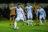 Friday  16 December 2014<br /> Pictured:  Liam Cullen of Swansea City scores from the penalty spot <br /> Re: Swansea City U18s v Wolverhampton Wonderers U18s, 3rd Round FA youth Cup Match at the Landore Training Facility, Swansea, Wales, UK