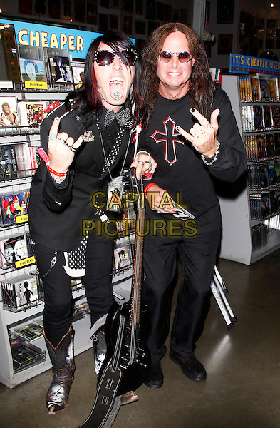 OZZY OSBOURNE FANS.Ozzy Osbourne signing his new album 'Scream', Amoeba Music, Los Angeles, California, USA..June 20th, 2010.full length black top sunglasses shades hand gesture mouth open tongue funny costume dress-up giutar.CAP/PE.©Peter Eden/Capital Pictures.