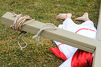 Roberto Marquez, of Bensalem, Pennsylvania portrays Jesus as he falls during the Stations of the Cross leading to his crucifixion on Good Friday April 3, 2015 at Our Lady of Fatima in Bensalem, Pennsylvania.  (Photo by William Thomas Cain/Cain Images)