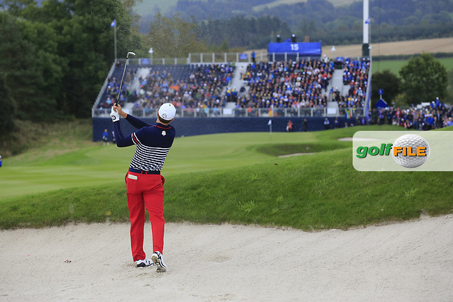 Jordan Spieth (USA) plays his 2nd shot from a fairway bunker on the 15th hole during Sunday's Singles Matches of the Ryder Cup 2014 played on the PGA Centenary Course at the Gleneagles Hotel, Auchterarder, Scotland.: Picture Eoin Clarke, www.golffile.ie: 28th September 2014