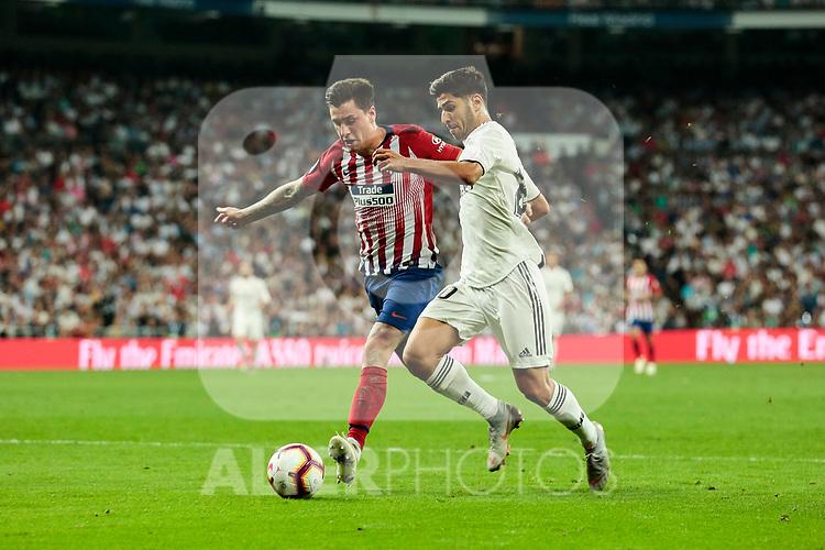 Real Madrid's Marco Asensio and Atletico de Madrid's Rodrigo Hernandez during La Liga match between Real Madrid and Atletico de Madrid at Santiago Bernabeu Stadium in Madrid, Spain. September 29, 2018. (ALTERPHOTOS/A. Perez Meca)