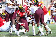 College Park, MD - September 22, 2018: Maryland Terrapins running back Tayon Fleet-Davis (8) is tackled by several Minnesota Golden Gophers defenders during the game between Minnesota and Maryland at  Capital One Field at Maryland Stadium in College Park, MD.  (Photo by Elliott Brown/Media Images International)