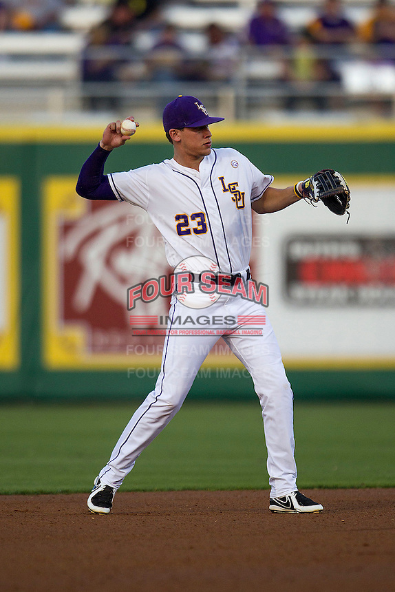 LSU Tigers second baseman JaCoby Jones #23 makes a throw to first base against the Auburn Tigers in the NCAA baseball game on March 22nd, 2013 at Alex Box Stadium in Baton Rouge, Louisiana. LSU defeated Auburn 9-4. (Andrew Woolley/Four Seam Images).