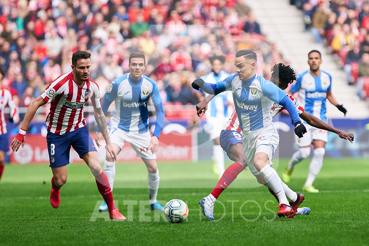 Thomas Teye of Atletico de Madrid and Roque Mesa of CD Leganes during La Liga match between Atletico de Madrid and CD Leganes at Wanda Metropolitano Stadium in Madrid, Spain. January 26, 2020. (ALTERPHOTOS/A. Perez Meca)