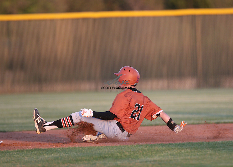 Westwood Warriors Chad Dixon (21) slides into second base during a high school baseball game between Rouse High School and Westwood High School, at Rouse High School in Leander, Texas, on Tuesday, March 22, 2016.