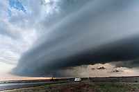 A Shelf Cloud Hovers Above a Car on the Side of the Road in Oklahoma on April 26, 2013