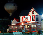 Night scene along Rehoboth Avenue.  Rehoboth Beach, Delaware, USA.  © Rick Collier