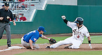Reno Aces Ryan Budde is called safe as he slides in the third as Las Vegas 51s Mike McCoy make the tag during their game on Monday night July 3, 2012 at Aces Ballpark in Reno, NV.
