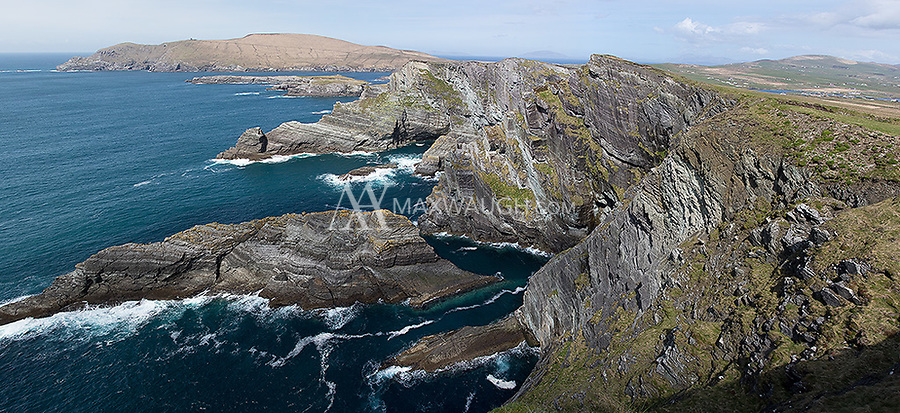 The Kerry Cliffs lie across the water from Skellig Michael.