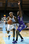 21 December 2013: North Carolina's Xylina McDaniel (left) and High Point's Latrice Phelps (right). The University of North Carolina Tar Heels played the High Point University Panthers in an NCAA Division I women's basketball game at Carmichael Arena in Chapel Hill, North Carolina. UNC won the game 103-71.
