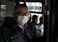 """BOGOTA, COLOMBIA - March 13:  A man wears a face mask as he rides the public transportation """"Transmilenio"""" on March 13, 2020 in Bogota, Colombia. The World Health Organization declared a global pandemic as the coronavirus rapidly spreads across the world. Colombian President Ivan Duque declared a health emergency to contain an outbreak of coronavirus, suspending public events with more than 500 people. (Photo by John W. Vizcaino/VIEWpress)"""