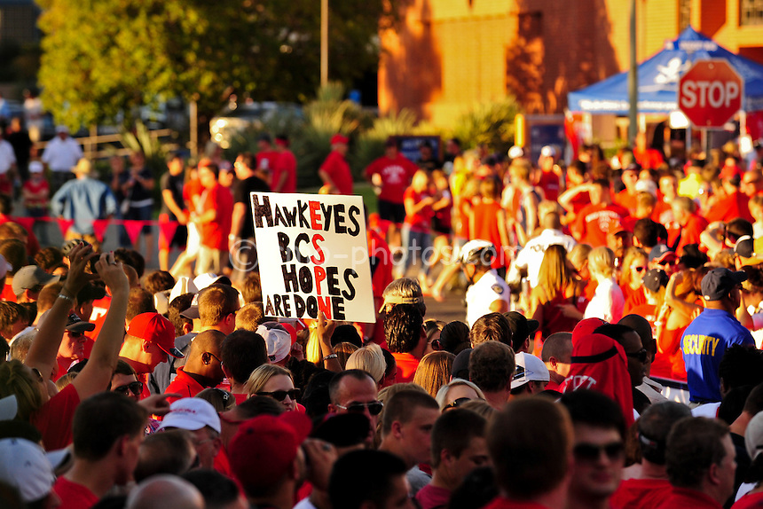 "Sept 18, 2010; Tucson, AZ, USA; An Arizona Wildcats fan holds up a sign during ""Wildcat Walk"" prior to a game against the Iowa Hawkeyes at Arizona Stadium."