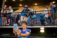 Seattle, WA - Saturday, July 02, 2016: Seattle Reign FC forward Nahomi Kawasumi (36) celebrates with fans after a regular season National Women's Soccer League (NWSL) match between the Seattle Reign FC and the Boston Breakers at Memorial Stadium. Seattle won 2-0.