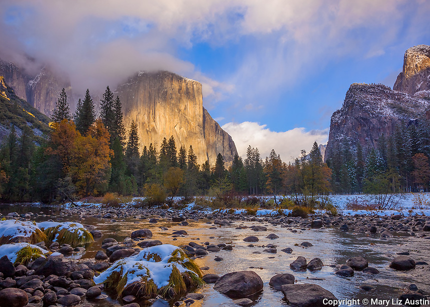 Yosemite National Park, CA: Clearing snowstorm at sunset illuminates El Capitan (7042 ft) and the Merced River in fall
