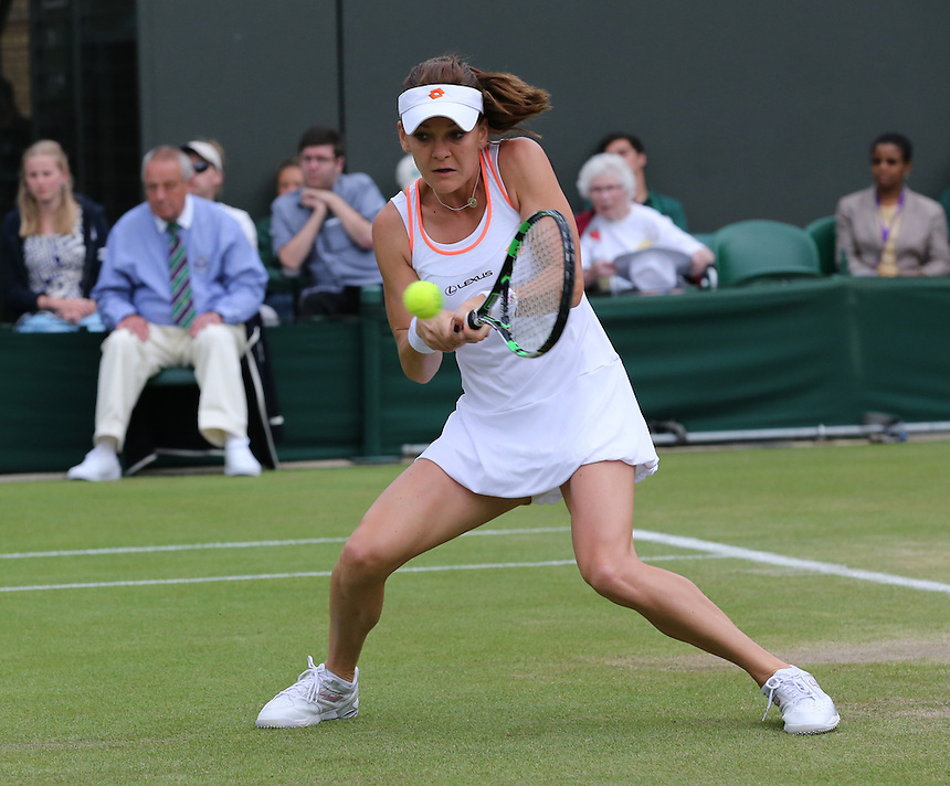 Agnieszka Radwanska (POL) [4] in action playing against Ekaterina Makarova (RUS) [22] in their Ladies' Singles Fourth Round match today<br /> <br /> Photographer Kieran Galvin/CameraSport<br /> <br /> Tennis - Wimbledon Lawn Tennis Championships - Day 7 Monday 30th June 2014 -  All England Lawn Tennis and Croquet Club - Wimbledon - London - England<br /> <br /> &copy; CameraSport - 43 Linden Ave. Countesthorpe. Leicester. England. LE8 5PG - Tel: +44 (0) 116 277 4147 - admin@camerasport.com - www.camerasport.com.