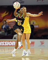 09.07.2011 Jamaica's nadine Bryan and Australia's Natalie Von Bertouch in action during the netball match between Jamaica and Australia at the Mission Foods World Netball Championship 2011 held at the Singapore Indoor Stadium in Singapore . Mandatory Photo Credit ©Michael Bradley.