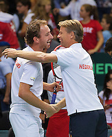 Switserland, Genève, September 19, 2015, Tennis,   Davis Cup, Switserland-Netherlands, Doubles: Matwe Middelkoop fals in to the arms of Capain Jan Siemerink<br /> Photo: Tennisimages/Henk Koster