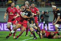 Sef Fa'agase tries to tackle Sam Cane during the Super Rugby match between the Chiefs and Reds at Yarrow Stadium in New Plymouth, New Zealand on Saturday, 6 May 2017. Photo: Dave Lintott / lintottphoto.co.nz