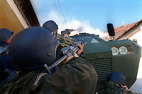 MACEDONIA. Tetovo. 16 March 2001..Macedonian  Police fire on ethnic Albanian rebel positions above the northern suburbs of Tetovo, Macedonia's second largest city..©Andrew Testa