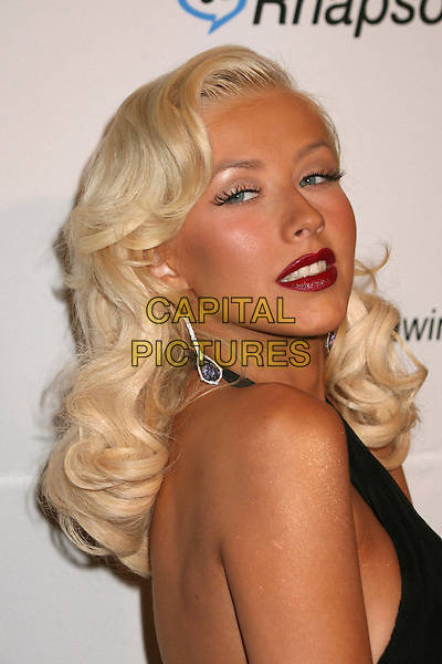 CHRISTINA AGUILERA.Clive Davis 2007 Pre-Grammy Awards Party at the Beverly Hilton Hotel, Beverly Hills, USA..February 10th, 2007.headshot portrait red lipstick dangling earrings black halterneck .CAP/ADM/BP.©Byron Purvis/AdMedia/Capital Pictures