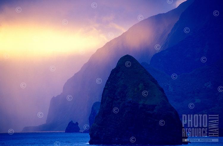 Misty view of the north coastline off the Kalaupapa peninsula, with Okala Island (aka Musubi Rock) in the foreground
