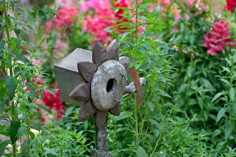 Bird house and snap dragons. in Tucson Botanical Gardens. Tucson. Arizona