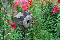 Bird house and snap dragons. in Tucson Botanical Gardens. Tucson. Arizona