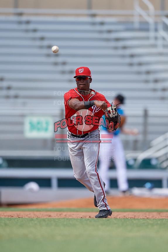 Washington Nationals Junior Martina (4) throws to first base during an Instructional League game against the Miami Marlins on September 25, 2019 at Roger Dean Chevrolet Stadium in Jupiter, Florida.  (Mike Janes/Four Seam Images)