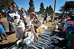Blessing Manditsera sells items from his stand in the Mbare Market in Harare, Zimbabwe. Manditsera's legs were paralyzed when he suffered from tuberculosis, and he today uses a wheelchair provided by the Jairos Jiri Association with support from CBM-US.