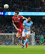 9th January 2018, Etihad Stadium, Manchester, England; Carabao Cup football, semi-final, 1st leg, Manchester City versus Bristol City; Raheem Sterling of Manchester City challenges Aden Flint of Bristol City for the ball