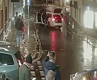 BNPS.co.uk (01202 558833)<br /> Pic: BNPS<br /> <br /> PICTURED: Shocked onlookers watch on in Swanage.<br /> <br /> This is the shocking moment cocky thieves stage a lengthy raid on a jewellers in front of dozens of pub drinkers.<br /> <br /> A crowd of more than 20 customers gathered outside and watched as the five masked men armed with machetes broke into the premises 30ft away.<br /> <br /> The brazen gang spent five minutes calmly carrying out the raid that was caught on the pub's CCTV and camera phones filmed by witnesses.<br /> <br /> Members of the public were threatened with the deadly weapons and acid spray if they tried to intervene.<br /> <br /> One brave woman was seen to confront them but backed off when threatened with a crowbar.