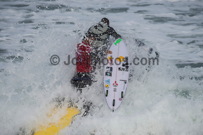 BELLS BEACH, Victoria/AUS (Sunday, March 27, 2016) Adriano de Souza (BRA)  - Action at the Rip Curl Pro Bells Beach, the second stop on the World Surf League (WSL) Championship Tour (CT), continued today with Round Two and six heats of Round Three of the Men's heats.<br /> There were light onshore South West winds throughout the day with the swell in the 6'-8' range.<br /> <br /> Bells Beach has been hosting surfing tournaments for more than 50 years now, making it the most renowned spot on the raw and rugged southern coast of Victoria, Australia. The list of  Rip Curl Pro event champions is a veritable who's who of surfing icons, including many world champions.<br /> <br /> Surfing's greats have a way of dominating Bells. Mark Richards, Kelly Slater, and Mick Fanning all have four Bells trophies; Michael Peterson and Sunny Garcia, three; While Simon Anderson, Tom Curren, Joel Parkinson, Andy Irons, and Damien Hardman each grabbed a pair.<br /> <br /> The story is similar on the women's side. Lisa Andersen and Stephanie Gilmore have four Bells titles; Layne Beachley and Pauline Menczer, three; while Kim Mearig and Sally Fitzgibbons each have two.<br /> <br /> The 2016 event is about to kick off tomorrow and there was a packed warm up session at Bells this morning. <br /> Photo: joliphotos.com