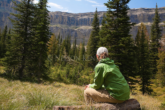 Enjoying a view of the Chinese Wall after backpacking into the Bob Marshall Wilderness in Montana