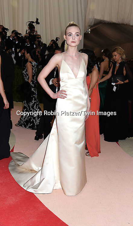Elle Fanning attends the Metropolitan Museum of Art Costume Institute Benefit Gala on May 2, 2016 in New York, New York, USA. The show is Manus x Machina: Fashion in an Age of Technology. <br /> <br /> photo by Robin Platzer/Twin Images<br />  <br /> phone number 212-935-0770