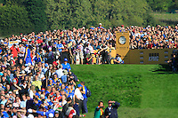 Graeme McDowell and Hunter Mahan wait amidst the huge crowds on the 17th tee in Match 12 of the Singles Matches during the Final Day of the The 2010 Ryder Cup at the Celtic Manor, Newport, Wales, 3rd October 2010..(Picture Eoin Clarke/www.golffile.ie)