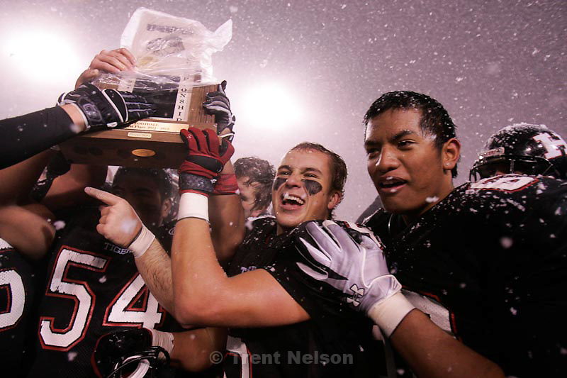 Trent Nelson  |  The Salt Lake Tribune.Hurricane players celebrate with the championship trophy after they defeated Desert Hills 21-0 in the 3A State Championship high school football game at Rice-Eccles Stadium in Salt Lake City, Utah, Friday, November 18, 2011.