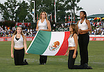 Four Railhawks cheeleaders hold the Mexico flag before the game. The United Soccer League Division 1 Carolina Railhawks played Club Deportivo Cruz Azul of La Primera Division del Futbol Mexicano on Wednesday, July 25, 2007 in an international club friendly game at SAS Stadium in Cary, North Carolina/