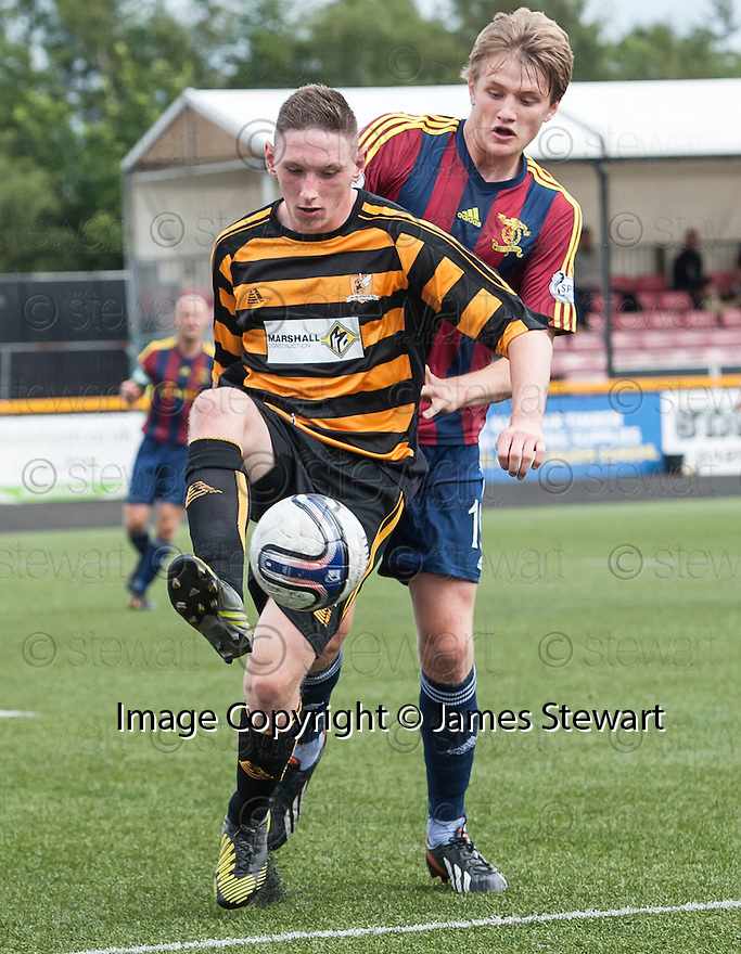 Alloa's Declan McManus holds off Livy's Coll Donaldson.