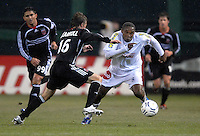 CD Olimpia midfielder Wilson Palacios (8) dribbles the ball to get away from DC United midfielder Brian Carroll (16). DC United defeated CD Olimpia 3-2 to advance to the semi finals of the CONCACAF Champions' Cup. March 1, 2007 at RFK Stadium in Washington DC.