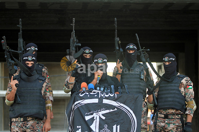 Palestinian militants from Al Nasser Brigades, an armed wing of the Popular Resistance Committees (PRC), take part in a training session in Gaza City, Sept. 28, 2013. Photo by Mohammed Asad
