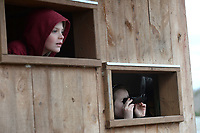 NWA Democrat-Gazette/ANDY SHUPE<br /> Frank Prassel (left) and Emerson Crenshaw, both 8-year-old students at Butterfield Trail Elementary School, look for birds Thursday, March 14, 2019, from inside the Mulhollan Waterfowl Blind while on a field trip to learn about birds at the Botanical Garden of the Ozarks. Gifted and talented students from Fayetteville Public Schools spent the day at the gardens learning about ornithology through instruction from garden volunteers and district teaching staff.
