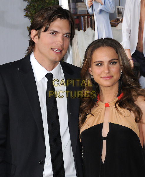 """ASHTON KUTCHER & NATALIE PORTMAN .attends the Paramount Pictures' L.A. Premiere of """"No Strings Attached"""" held at The Regency Village  Theatre in Westwood, California, USA,.January 11th 2011..half length white shirt black tie  suit dress beige camel cut out pregnant maternity sleeveless .CAP/RKE/DVS.©DVS/RockinExposures/Capital Pictures."""