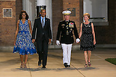United States President Barack Obama, left, First Lady Michelle Obama, center left, U.S. Marine Corps Commandant General James F. Amos, center right, and his wife Bonnie, right, arrive at the Marine Barracks Washington, DC for the Evening Parade in Washington, D.C., on Friday, June 27, 2014. <br /> Credit: Kristoffer Tripplaar  / Pool via CNP