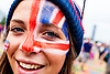 Smiling young woman with Union Jack face paint in the Olympic Park, during the London 2012 Games