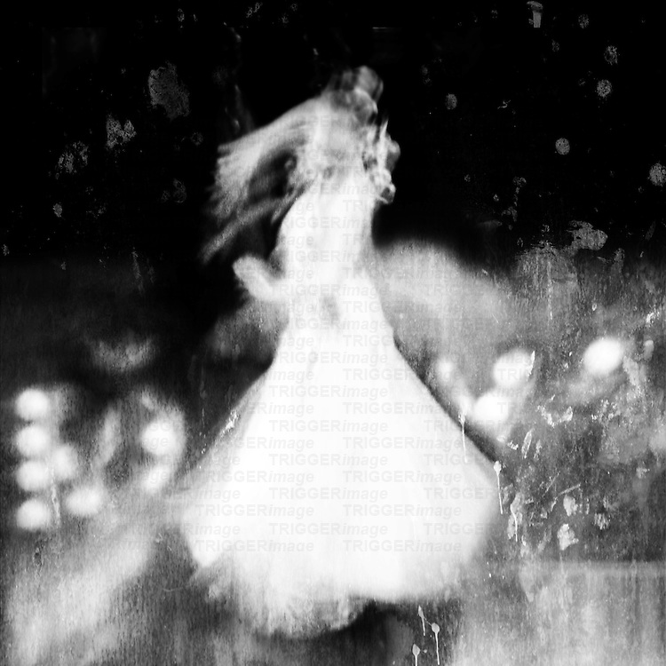 A woman in a long gown swirls as she dances under a star-filled sky